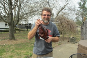 Wes Berry Holding Mutton Leg