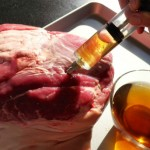 Injecting marinade into ham