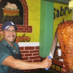 Carving the pork for tacos al pastor