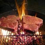 Porterhouse steaks on grill