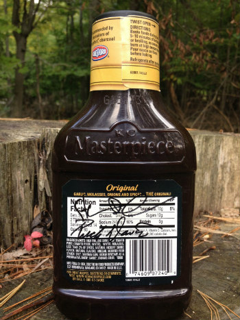 Bottle of KC Masterpiece Barbecue Sauce signed by Rich Davis and Steven Raichlen