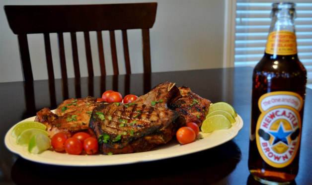 Grilled Pork Porterhouses with Newcastle Brown Ale and Mustard - Barbecuebible.com