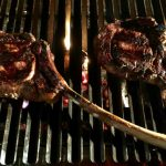Tomahawk steaks on grill