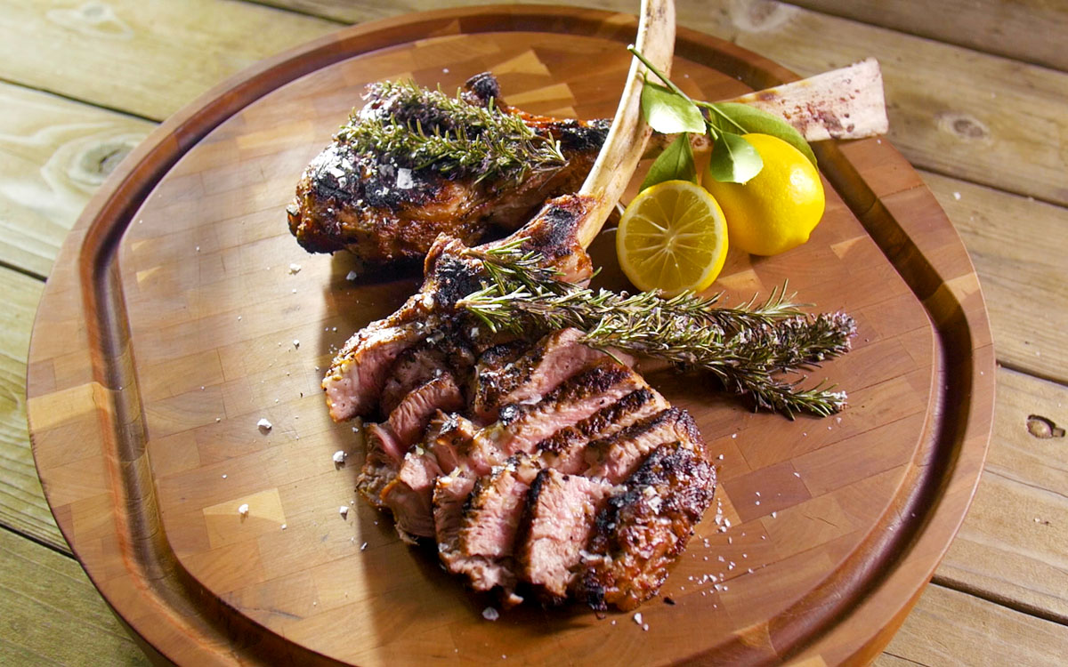 Grilled Veal Chops with Smoking Rosemary - Barbecuebible.com