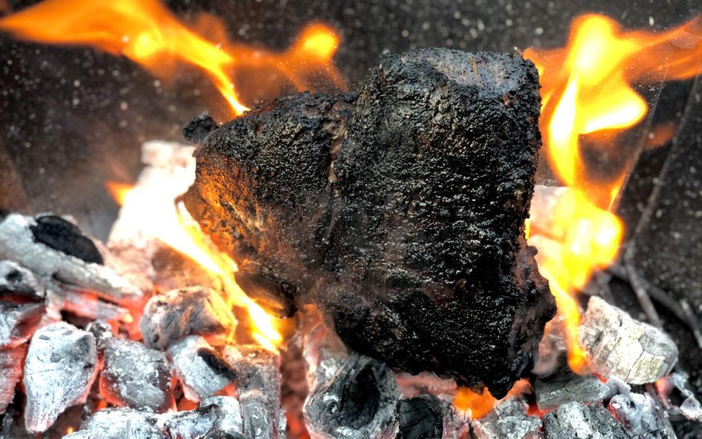 Caveman steak on coals